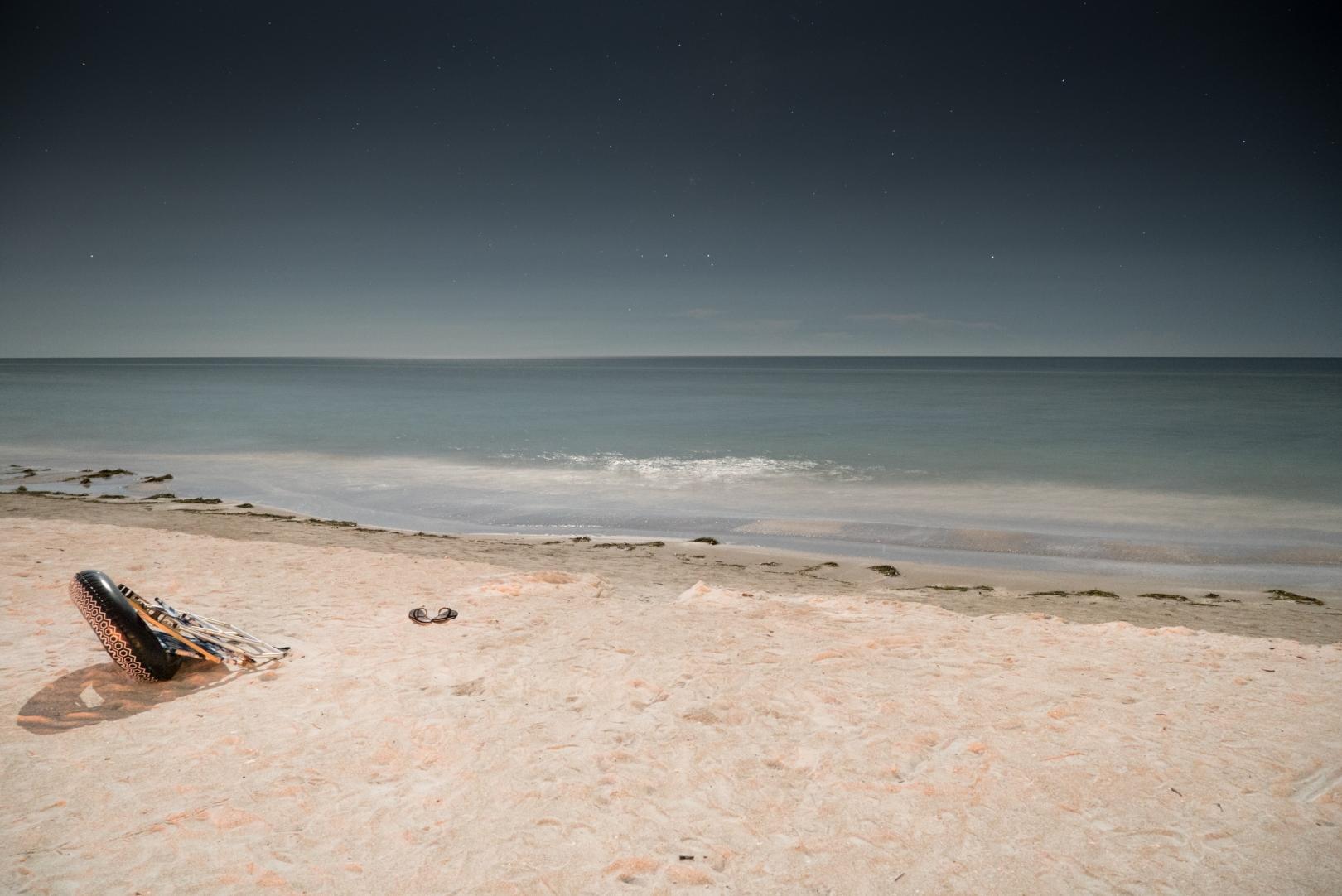 10.0 sec at f - 4.0 ISO 6400, Sony FE 23-70 f/4.  Beach under moonlight.