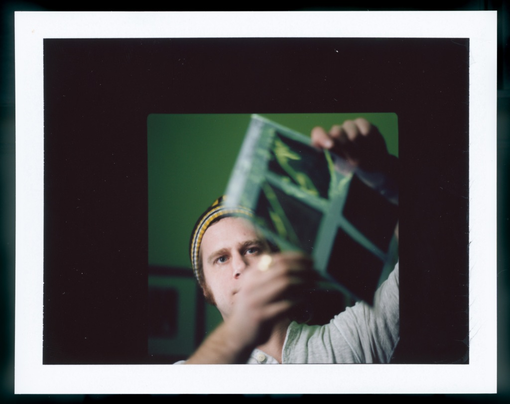 1/60 @ f/8 ISO 100 Fuji FP100C instant film. Checking out some unscanned negatives.