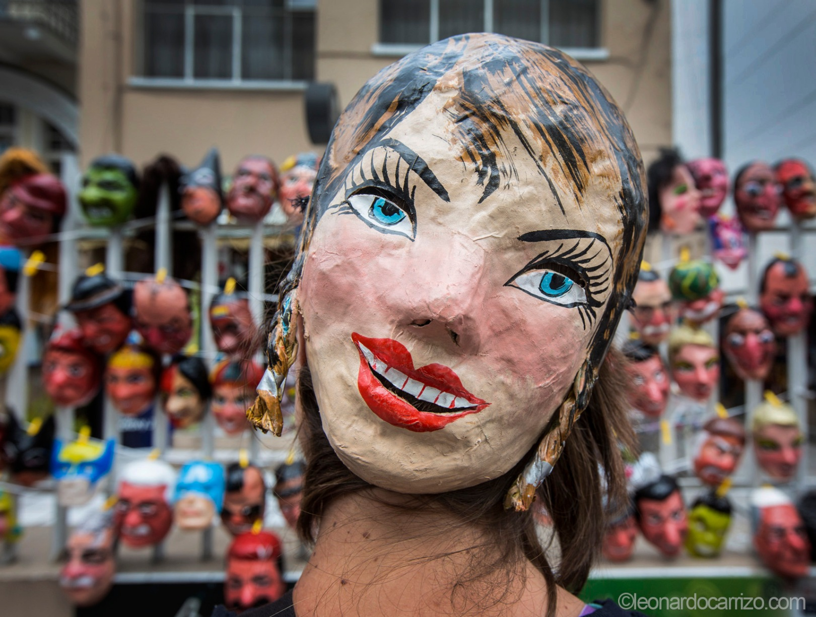 """Traditional masks, made of paper and hand painted, are used to celebrate the end of the year in Ecuador. They are use in combination with paper filled dummies created from old clothes to figurative burn the """"old year"""" at midnight and celebrate the New Year. (photo by Leonardo Carrizo)"""